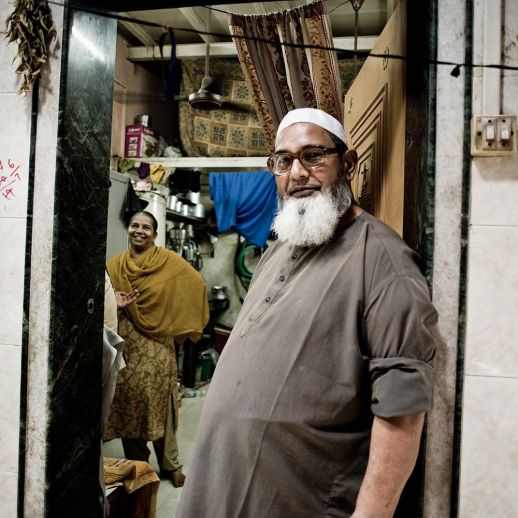 My home is not a slum: A friendly couple welcomes you to their home in Dharavi – otherwise misrepresented as the largest slum in Asia. (Photo by Brooks Reynolds for urbz).