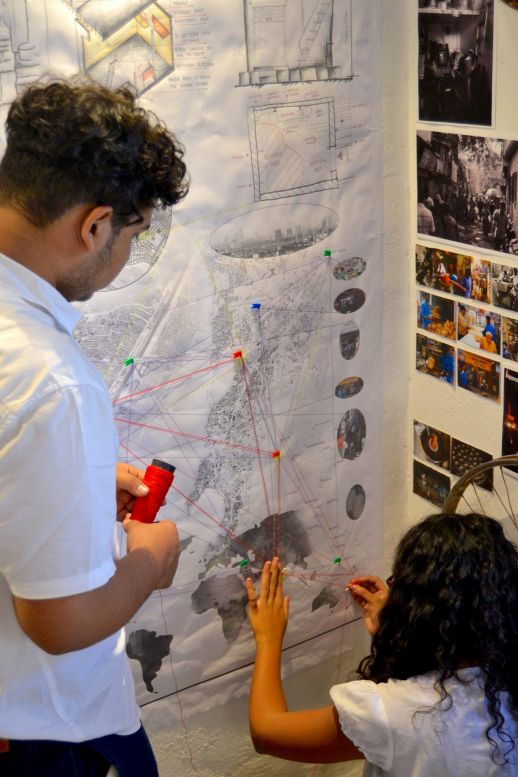 Students map the connections of their stories from Dharavi to the rest of the world.