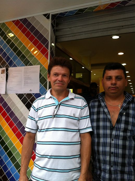Pedreiro Ataide with market owner in front of the store. Trust and reputation is everything for a local builder.
