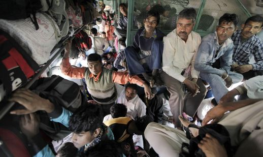 Passengers on a train in New Delhi, India. Photograph: Raj K Raj/Hindustan Times/Getty