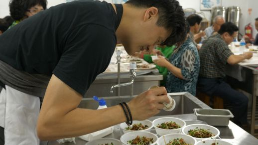 Chef Kim prepares for a final meal with local herbs and ingredients.