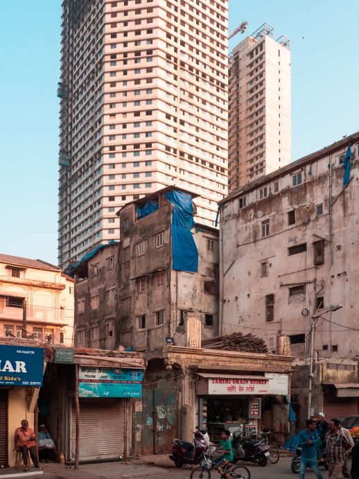 The contrast between new high-rises and older buildings is evident in Mumbai.