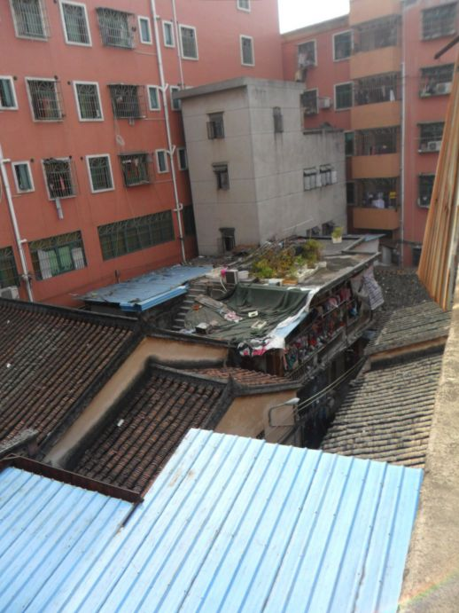 View from Ching's house in ShiYan village. The photo clearly shows how the older, traditional looking houses have been extended and crowded by new buildings, which are now rising to multiple levels.