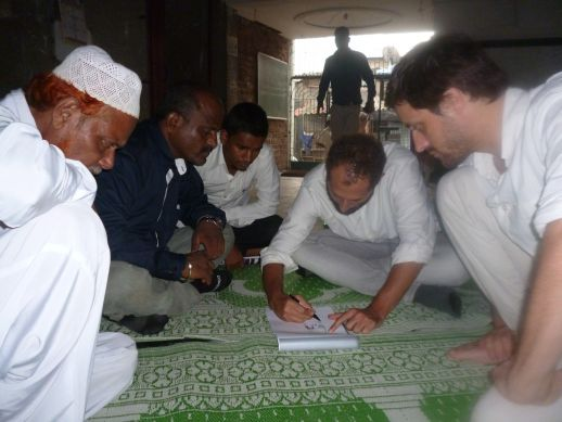 Masoom Moitra and Matias Echanovediscussing the design with the mosque committee.