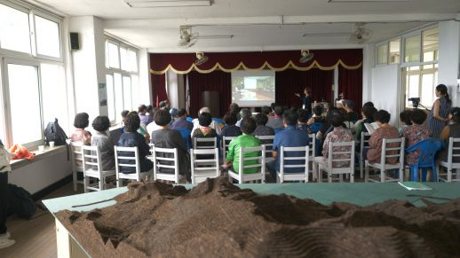 Local villagers attend discussions during the workshop