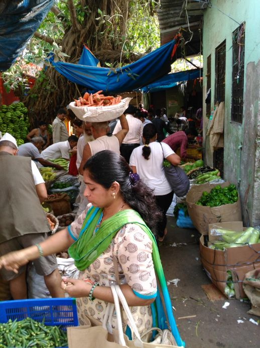 Kavita buying fresh vegetables and herbs at Dadar market.