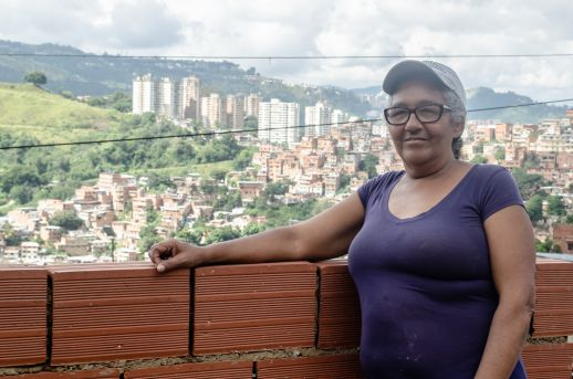 Yolanda Vegas stands in the third floor in process of her neighbors home, overseeing Petare, the place she has called home for the last 50 years. Photograph by Stephanie Marcelot
