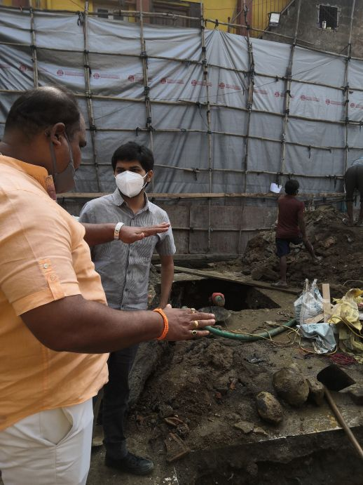 urbz team on site with contractor Joseph Koli, Dharavi