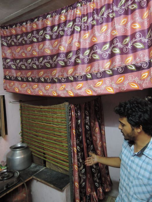 Lavish Jain showing the simple partition system  he made for a couple's home.