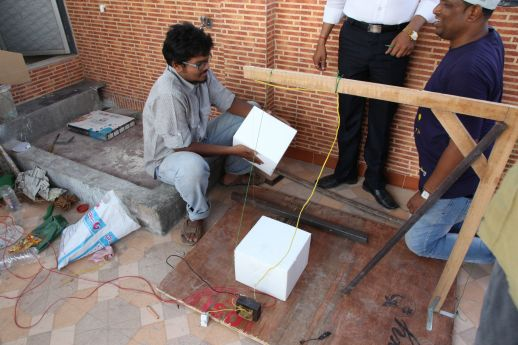 Bharat and Shardul cutting EPS blocks to build the future URBZ office. Extra light construction allow existing houses to be expanded vertically without adding much weight on the structure.