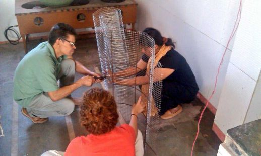 Ataide, Aditi and Marcella working on a ferrocement structure to cover an open drain.